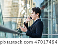 Business man talking on the phone   47017494