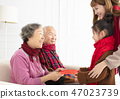Asian family celebrate Chinese new year at home 47023739