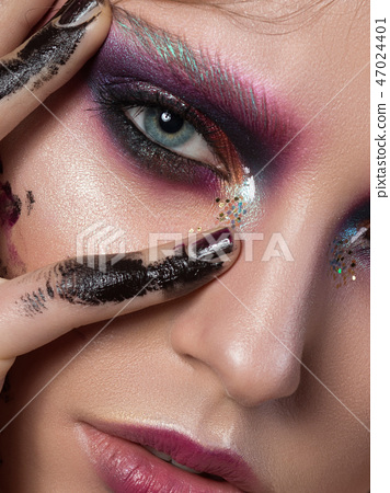 Young girl with fashion creative make up 47024401