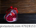 Valentines background with bouquet rose in gift box and mini gift box on dark wooden background 47028153