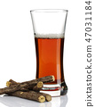 Liquorice root and a glass of tea 47031184