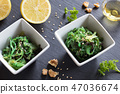 Fresh seaweed salad in two square bowls 47036674