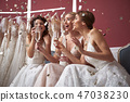 Waist up of cheerful brides with champagne glasses 47038230