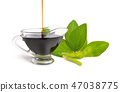 A bowl of soy sauce with plant. Isolated  47038775
