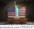 Statue of liberty andsuitcase with flag of USA 47039147