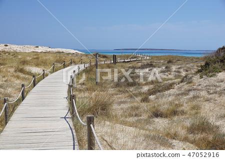 flip-flops on a sunny pile of sand . beach slipper on the beach 47052916