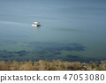 white yacht at sea with tourists swim to the shore 47053080