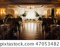 Wedding reception decoration with different electric edison lamps and fresh flowers, rustic style 47053482
