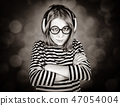 Sad girl with headphone and glasses.  47054004
