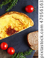 Omelette with whole wheat bread and tomato cherry 47056163