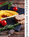 Omelette with whole wheat bread and tomato cherry 47056164