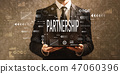 Partnership with businessman holding a tablet computer  47060396