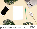 Exotic plants and working accessories on pale yellow background. 47061926