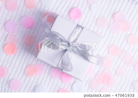 Beautiful gift box on white background with confetti. 47061938