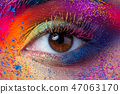 Close up view of female eye with bright multicolored fashion mak 47063170