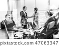 Business people shaking hands in moder corporate office. 47063347