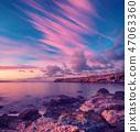 Sunrise at sea 47063360