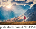 Woman on the hill is looking on the mountains  47064958