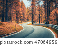Winding mountain road in autumn forest at sunset 47064959