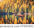Wooden boats on Braies lake at sunrise in autumn 47064961