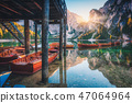 Wooden boats near the house in Braies lake  47064964