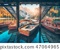 Wooden boats near the house in Braies lake 47064965