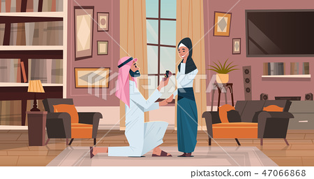 arab man kneeling holding engagement ring proposing arabic woman marry him couple in love wedding 47066868