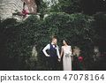 Wedding couple bride and groom holding hands 47078164