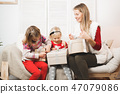 holidays, presents, christmas, x-mas, birthday concept - happy mother and child girl with gift box 47079086