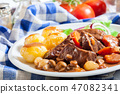 Beef Bourguignon stew served with baked potatoes 47082341