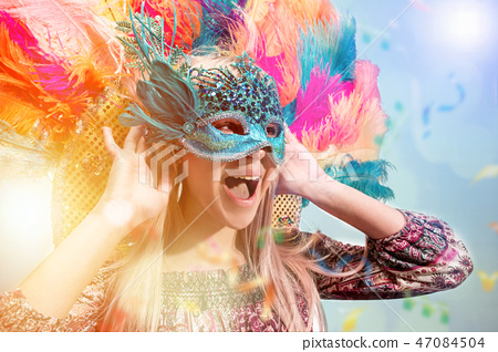 Beautiful young woman in carnival mask 47084504