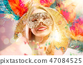 Beautiful young woman in carnival mask 47084525