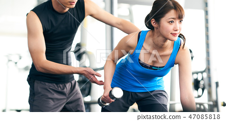 Trainers and women who train their arms 47085818
