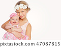 happy beautiful girl with baby baby sister 47087815