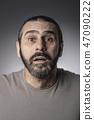 surprised man studio shot 47090222