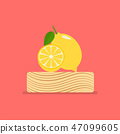 Fresh lemon on wood chopping block 47099605