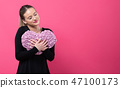 Woman holding a heart cushion in Valentine's day theme 47100173