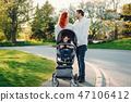cute family in a sunny park 47106412