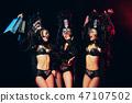 young beautiful dancers posing on studio background 47107502