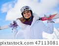 Portrait of beautiful woman with ski and ski suit in winter moun 47113081
