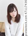 年輕女士的髮型 47117436