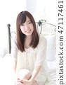 年輕女士的髮型 47117461