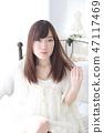 年輕女士的髮型 47117469