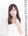 年輕女士的髮型 47117479