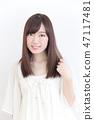 年輕女士的髮型 47117481