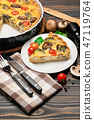 Slice of traditonal homemade spinach chicken quiche tart or pie on plate 47119764