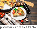 Slice of traditonal homemade spinach chicken quiche tart or pie on plate 47119767