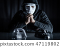 Mystery man choosing mask on the table 47119802