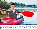 Man kayaking on lake 47120728