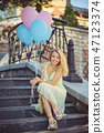Beauty girl with colorful balloons laughing  47123374